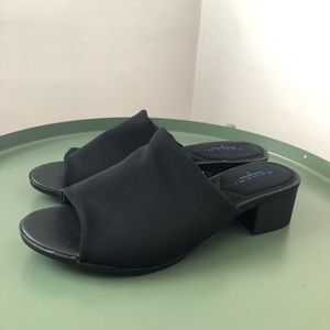 Cool chunky heel mule with an 80's vibe